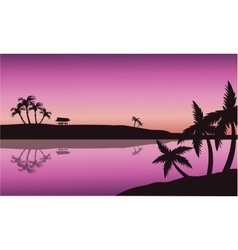 Silhouette of palm in seashore vector image