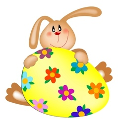 Easter bunny with a painted egg vector image