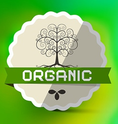Organic Label with Tree Sign on Green Blurred vector image vector image