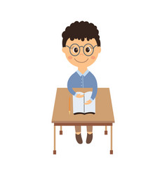 flat schoolboy sitting at desk isolated vector image vector image