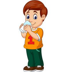 Cartoon boy drinking milk vector