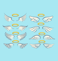 flying angel wings with gold nimbus set vector image