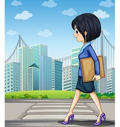 A woman walking at the street near the pedestrian vector