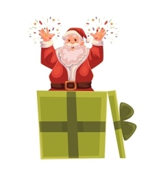 Full length portrait of santa popping out a box vector