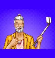 Old man with selfiestick and smartphone vector