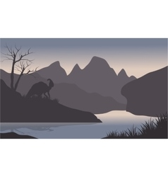 Silhouette of parasaurolophus in riverbank vector