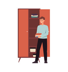 Happy man organising clothes in a closet young vector