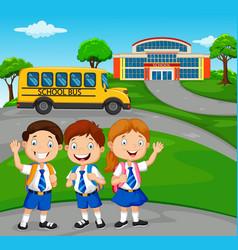 happy school children in front of the school vector image