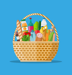 Wicker basket full of groceries products vector
