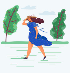 Young woman walking in windy weather through park vector