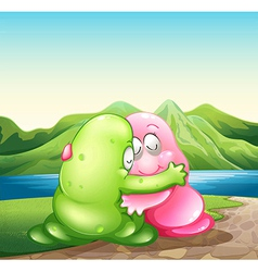 A green and a pink monster hugging each other at vector