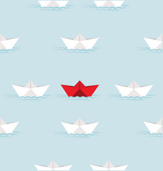red paper boat and white paper boat in water vector image