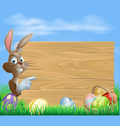 Easter bunny and eggs with wooden sign vector