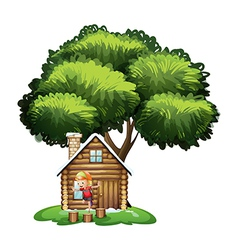 A house under the tree with a little boy playing vector image