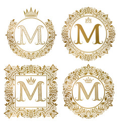 Golden letter m vintage monograms set heraldic vector