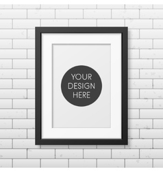 Realistic black frame A4 on the brick wall vector image