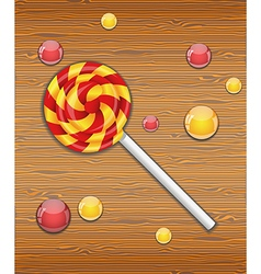 Colorful candy on wooden background vector image