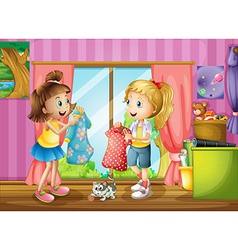 Two girls talking about their dresses vector image vector image