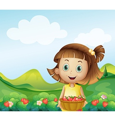 A girl holding a basket of strawberries vector