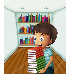 A boy carrying a pile of books vector
