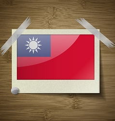 Flags Taiwan at frame on wooden texture vector image