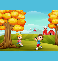 Happy children playing in farm background vector