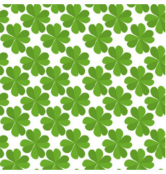 Seamless texture with flat lucky four-leaf clover vector