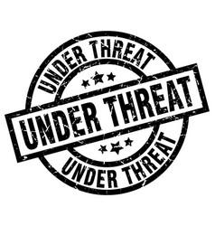 under threat round grunge black stamp vector image