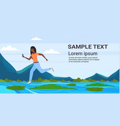 Brave african american woman using smartphone vector