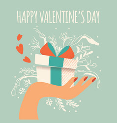 Hand holding a gift box with hearts coming out vector