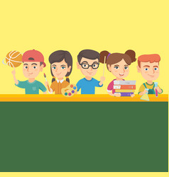 kids standing at the table with school supplies vector image vector image
