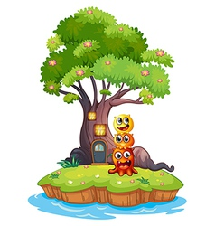 An island with three monsters under the giant tree vector