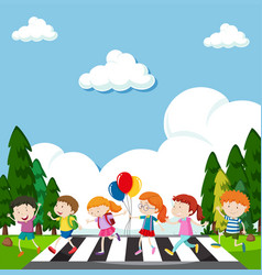 Many children crossing street vector