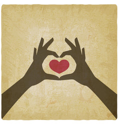 Hands in heart shape on vintage background vector