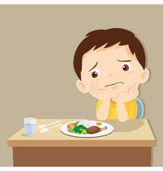 Boy bored with food vector