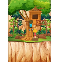 Boy and girl playing at the treehouse vector image