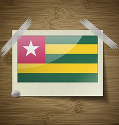 Flags Togo at frame on wooden texture vector image