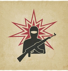terrorist with gun old background vector image vector image