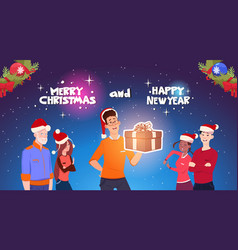 happy people wearing santa hats man holding vector image