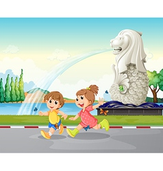 Two kids playing near the statue of Merlion vector image