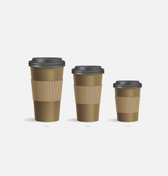 3 brown coffee cups mockup on grey background vector