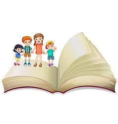 Children standing on big book vector image vector image