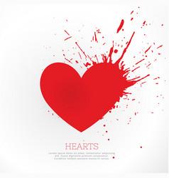 red heard with ink splatter vector image