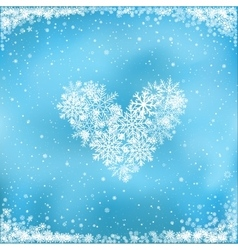 snow heart on blue background vector image