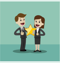 Businessman and businesswoman hold a big gold star vector