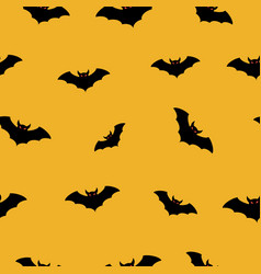 halloween bat fly seamless pattern vector image