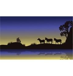 Zebra and meerkat at night scenery vector image