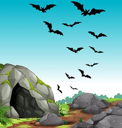 Bats flying out of the cave vector