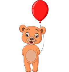 cartoon little bear holding a red balloon vector image