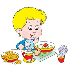boy at breakfast vector image